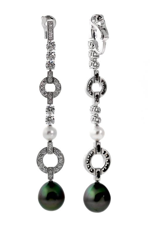 A Stunning Pair Of Cartier Diamond Drop Earrings Featuring White And Black Pearls Crafted In 18k