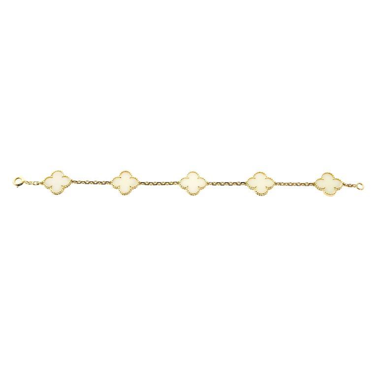 A magnificent vintage Van Cleef & Arpels 5 motif white coral Alhambra bracelet in 18k yellow gold.  Bracelet Length: 7.25