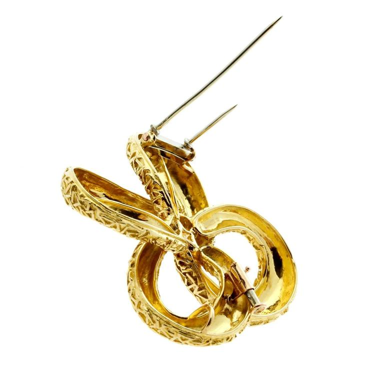 A stunning Van Cleef & Arpels gold brooch crafted in 18k yellow gold, may be worn as a necklace enhancer as well.
