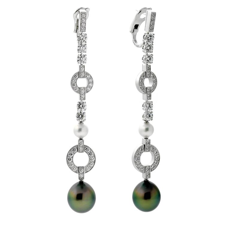 A stunning pair of Cartier diamond drop earrings featuring white and black pearls crafted in 18k White Gold. The earrings have a length of 3.25 Inches, and a weight of 24.5 grams  Cartier Est Retail: $58,000 + Tax Inventory ID: 0000078