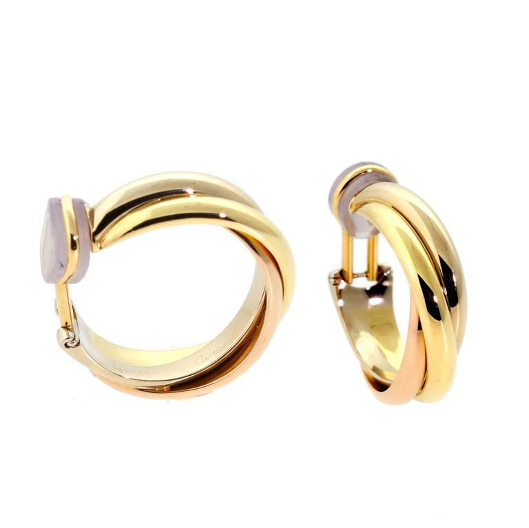 An Pair Of Cartier Trinity Hoop Earrings Featuring 18k White Yellow And Rose Gold To Form