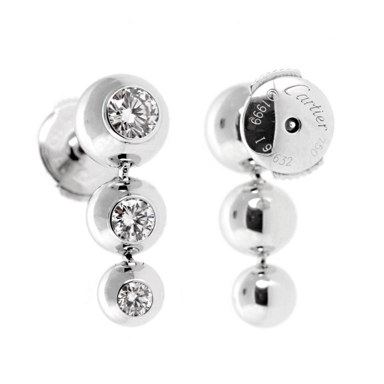 An Authentic Pair Of Cartier Diamond Earrings Each Featuring 3 The Finest Round Brilliant