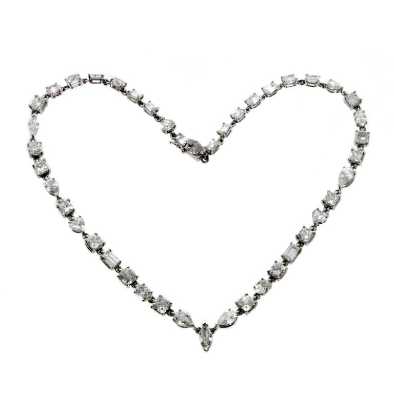 """A plethora of diamonds set in platinum, this fine necklace features multi-shaped diamonds for an exciting look. The necklace features a stunning 31cts of diamonds and has a length of 16""""  This magnificent piece is offered by Opulent Jewelers,"""