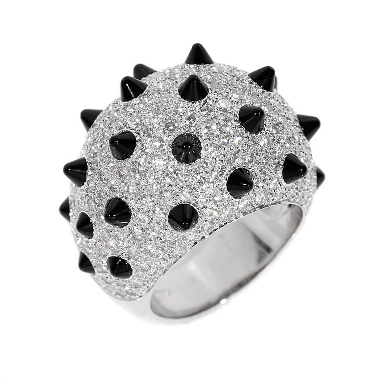 A fabulous authentic Cartier Panthere collection ring featuring 3.66 carats of the finest Cartier round brilliant cut diamonds and 2.43cts of onyx studs in 18k white gold.  Size 55 / US 6 1/2