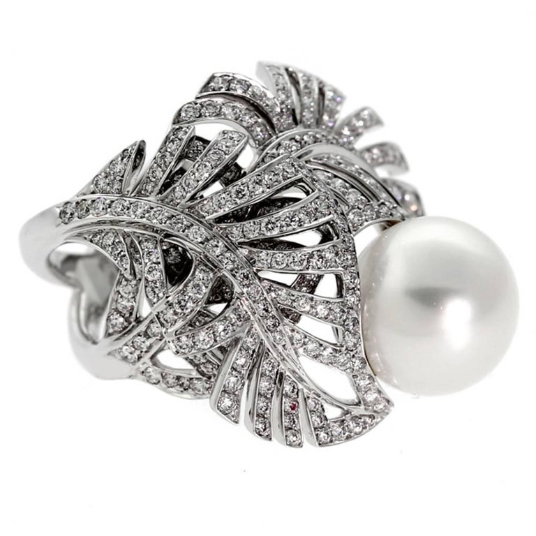 A magnificent authentic Chanel pearl and diamond ring featuring 1.72ct of the finest round brilliant cut diamonds set in 18k white gold.  This magnificent piece is offered by Opulent Jewelers, we are an accredited boutique dedicated to sharing our