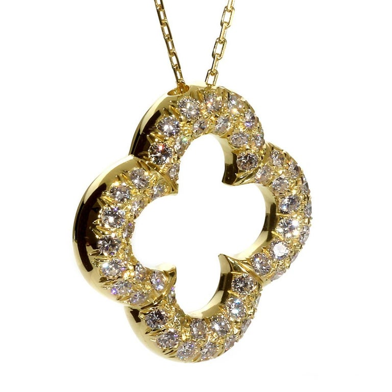 "A fabulous vintage Van Cleef and Arpels Alhambra necklace set with 52 of the finest round brilliant cut diamonds (2.08ct appx) in 18k yellow gold. The pendant measures 1"" by 1"" and the necklace has an adjustable length up to 18""  This magnificent"