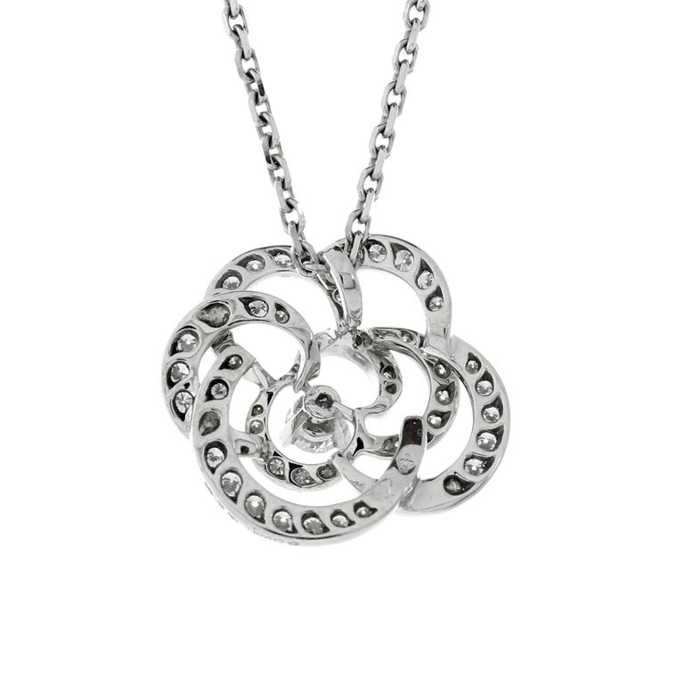 A fabulous Chanel necklace depicting a Camellia flower set with the finest Chanel round brilliant cut diamonds in 18k white gold.  Necklace Length: 16