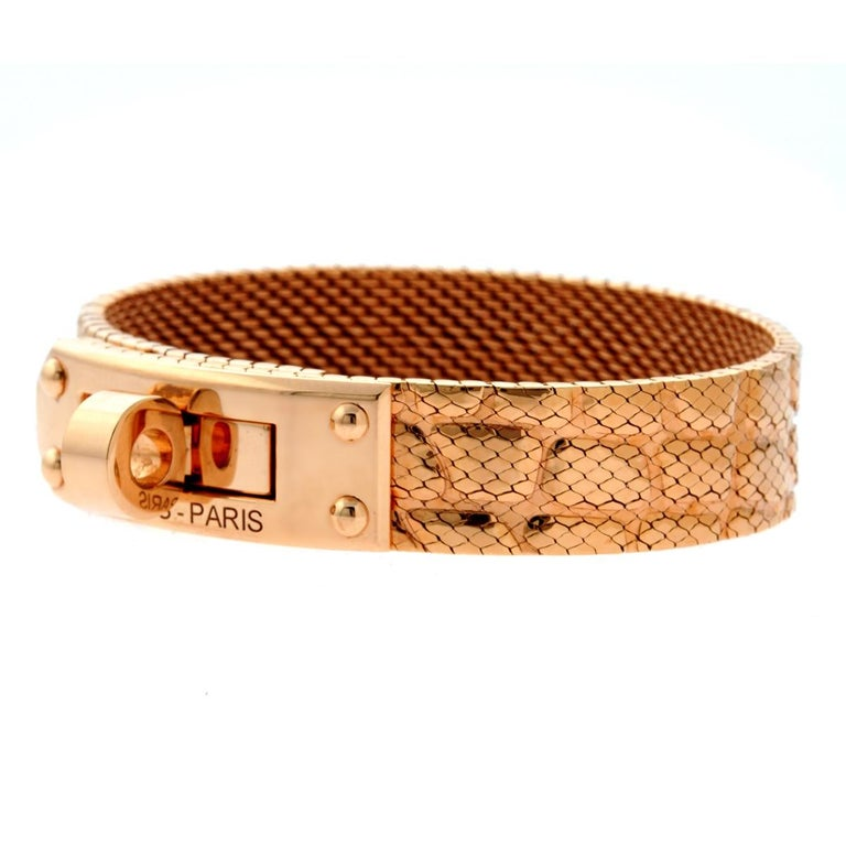 1c560f19a672 A stunning 18kt rose gold bracelet by Hermes from the Kelly collection