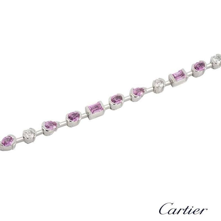 A beautiful 18k white gold diamond and sapphire Meli Melo bracelet by Cartier. The bracelet is composed of a row of alternating diamonds and pink sapphires with a total diamond weight of approximately 0.60ct. The pink sapphires vary in cuts