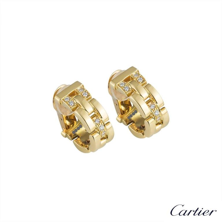 A pair of 18k yellow gold Maillon Panthere earrings by Cartier. Each hoop style earring is made up of iconic flat 18k yellow gold solid links with 3 pave set diamond intersections, totalling approximately 0.20ct. The earrings measure 2cm X 0.8cm and
