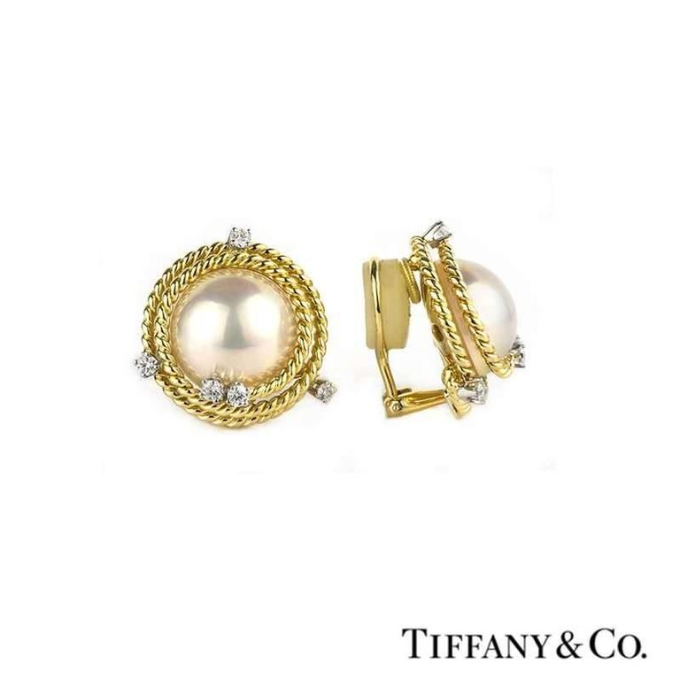 46c04ec71 A pair of 18k yellow gold pearl and diamond earrings by Tiffany & Co.
