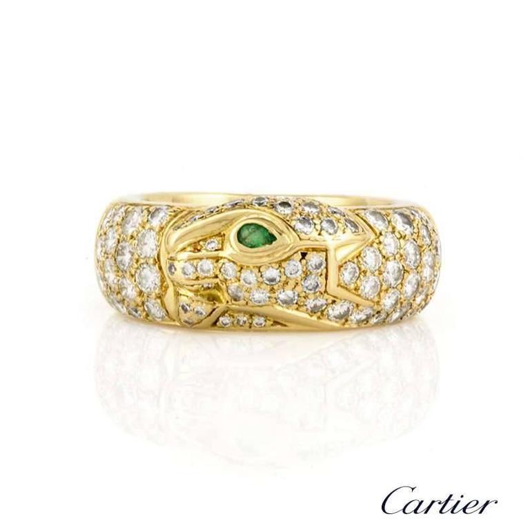 An 18k yellow gold diamond set ring from the Cartier Panthere collection. The ring is composed of the iconic Panthere head, of which is pave set with graduating round brilliant cut diamonds, leading on to the main body totalling approximately