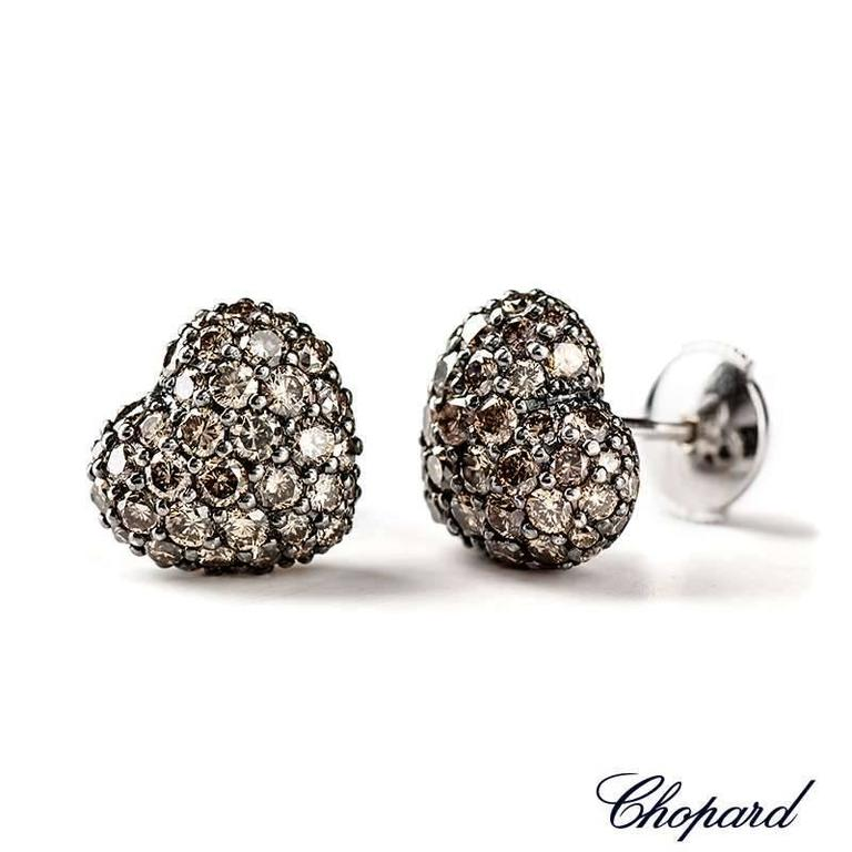 A pair of Chopard 18k white gold fancy brown diamond heart shape ear studs. Set with 106 diamonds totalling 2.51ct. The earrings are approximately 1cm x 1cm. Chopard Model No. 83/4203-1008  The earrings come complete with box and original Chopard