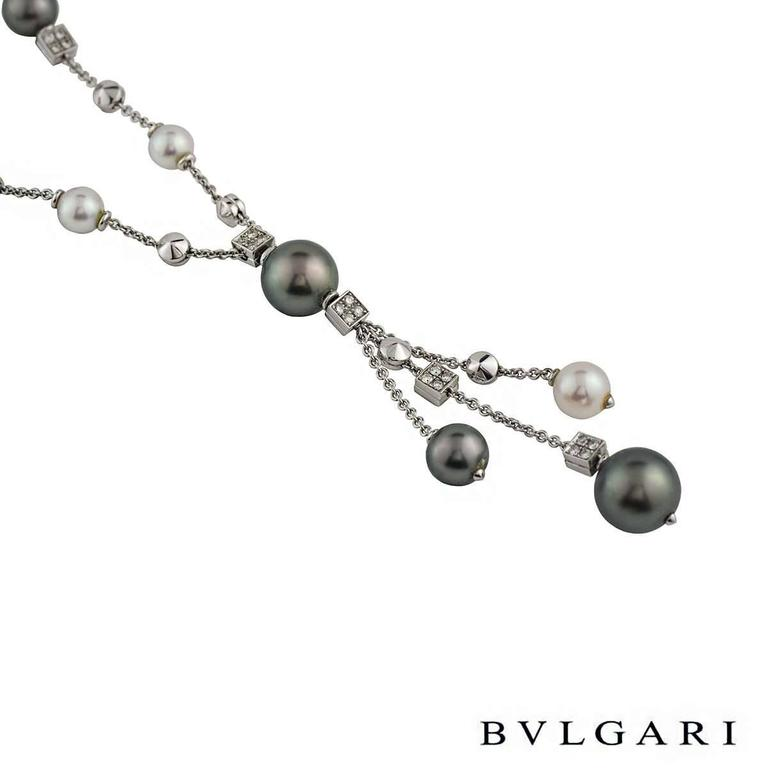 A beautiful pearl and diamond necklace from the Lucea collection by Bvlgari. The necklace features both Tahitian and white/pink pearls in a mixture of sizes, spread along the necklace and the vertical drop. The necklace also features 6 square links
