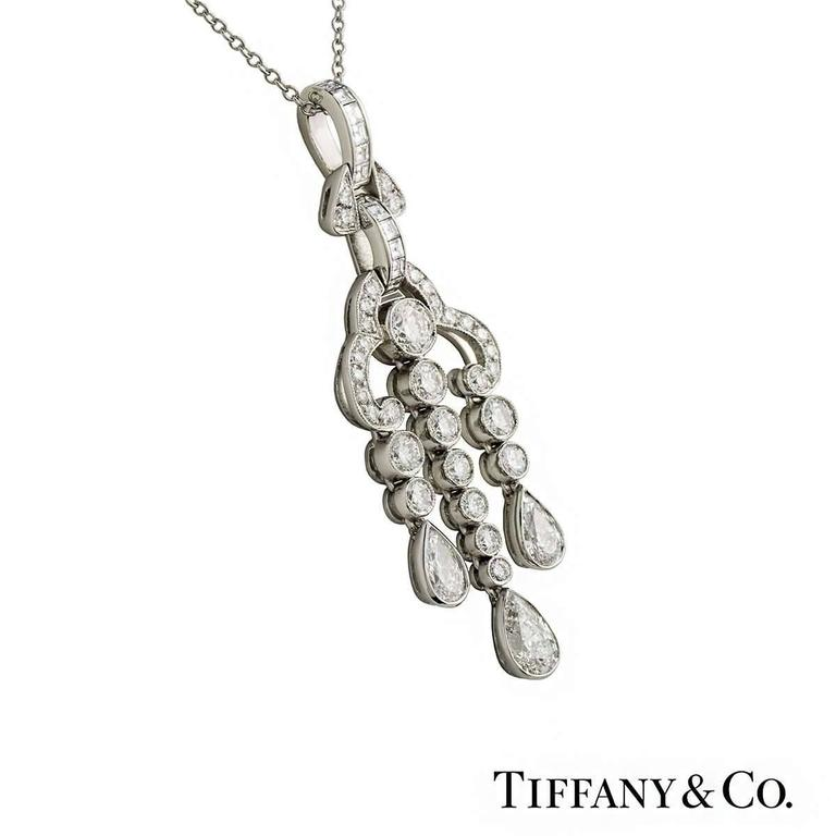 A beautiful Tiffany & Co. diamond pendant from the Legacy collection. The pendant comprises of 11 princess cut diamonds, 3 pear cut diamonds and 33 round brilliant cut diamonds set in a rubover setting in a chandelier style. The pendant has a
