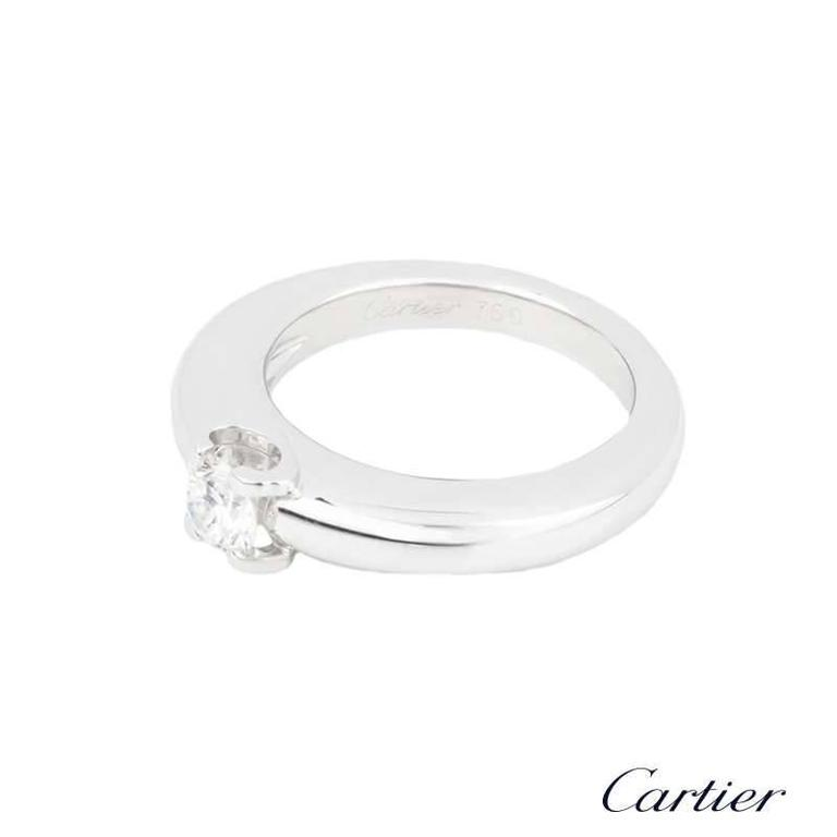 A beautiful 18k white gold diamond single stone ring from the C De Cartier collection by Cartier. The ring is set to the centre with a round brilliant cut diamond weighing approximately 0.33ct, E/F colour and VVS in clarity set in the iconic C de