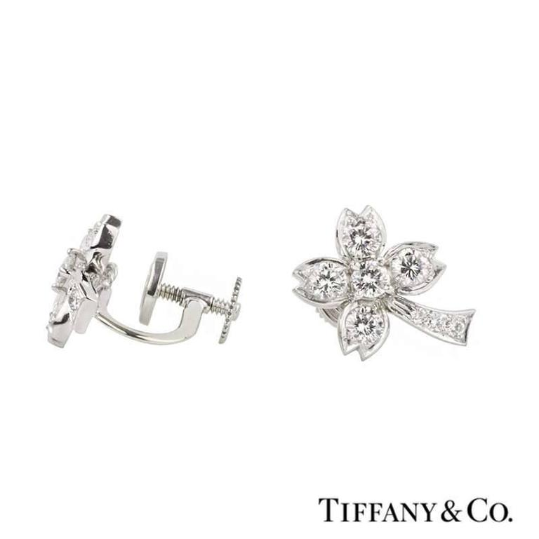 A stunning pair of diamond set palm tree earrings in platinum by Tiffany & Co. The earrings are in a plam tree design motif and are each set with five round brilliant cut diamonds through the leaves and branches and pave set with 3 graduating round