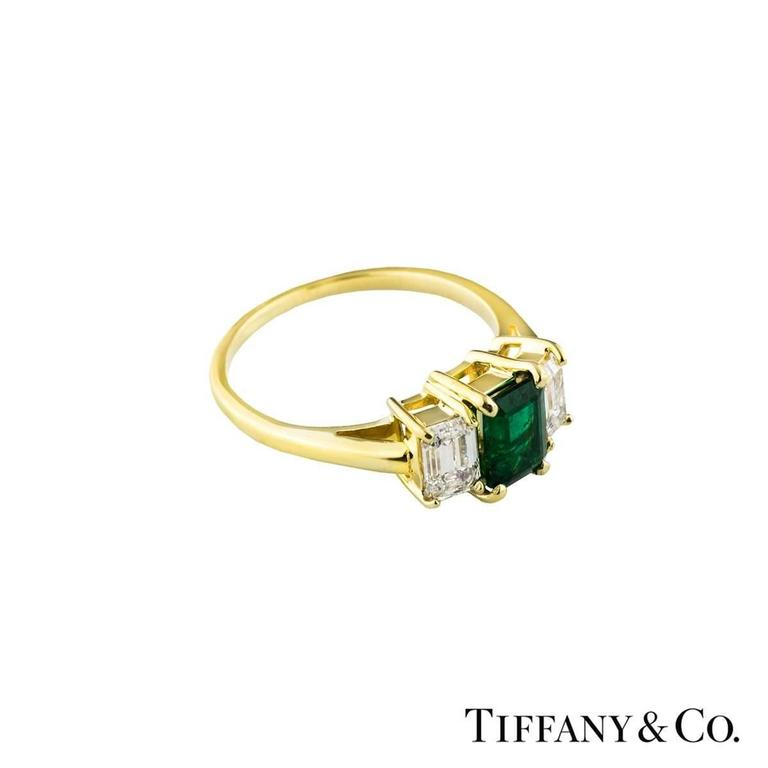 Emerald Cut Tiffany & Co. Emerald Diamond Yellow Gold Trilogy Ring For Sale