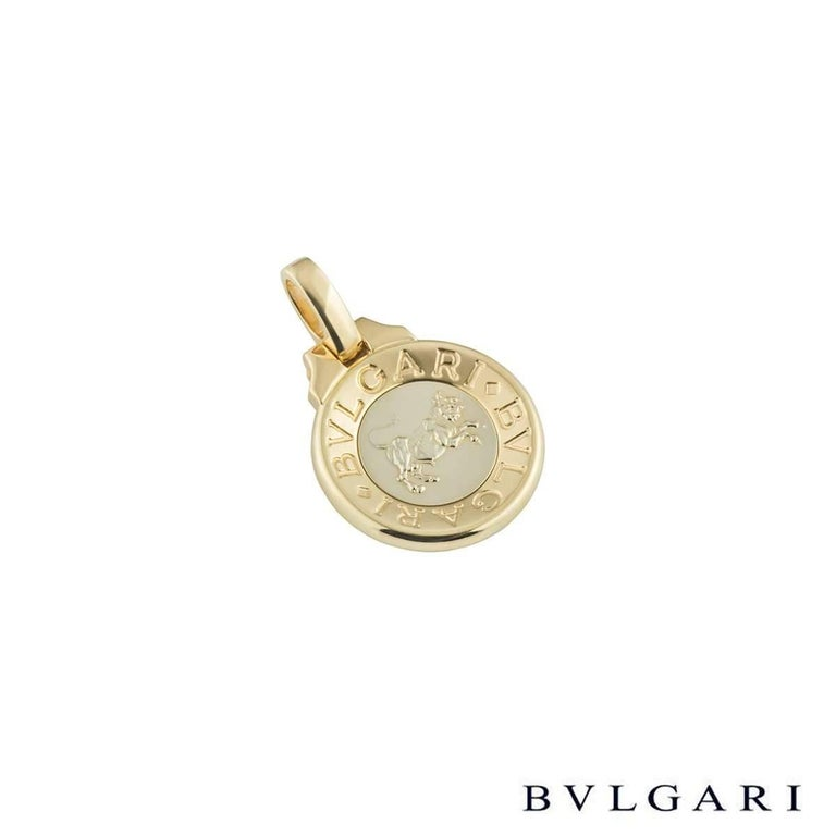 A unique 18k yellow and white gold Bvlgari zodiac pendant. The pendant comprises of a coin emblem with 'Bvlgari Bvlgari' around the outer edge. Complimenting this is a white gold centre with an embossed taurus zodiac sign. The pendant features a