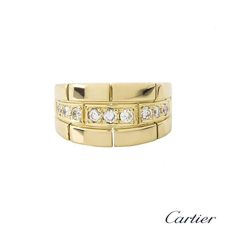 An 18k yellow gold diamond set dress ring by Cartier. The ring is set through the centre with 9 round brilliant cut diamonds in a pave setting, totalling approximately 0.33ct, G colour and VS in clarity. Accentuating the diamonds is a brick link