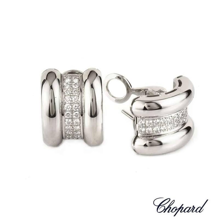 A classic pair of Chopard 18k white gold and diamond earrings from the La Strada collection. The earrings are comprised of three sections and cuff over the earlobe, the inner is pave set with 44 round brilliant cut diamonds totalling 0.92ct. The