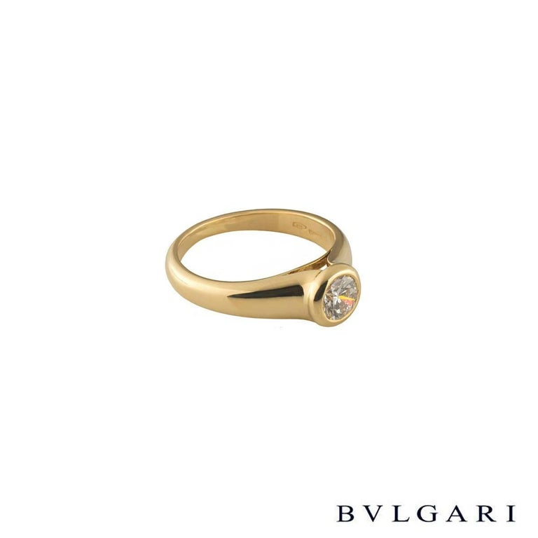 A unique 18k yellow gold Bvlgari diamond engagement ring. The ring comprises of a round brilliant cut diamond with a total weight of 0.49ct, F colour and VS1 clarity, set in a rubover setting. The ring is a US 4 1/4, EU size 47.5 and UK size I but