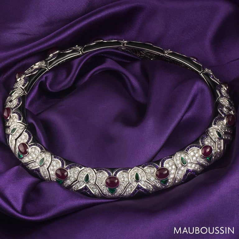 A luxurious 18k white gold Mauboussin multi-gemstone necklace. The necklace comprises of a choker style with a multi link motif placed like a jigsaw. The choker is encrusted with diamonds, Amethyst, Ruby, Emerald and Onyx. The diamonds are round