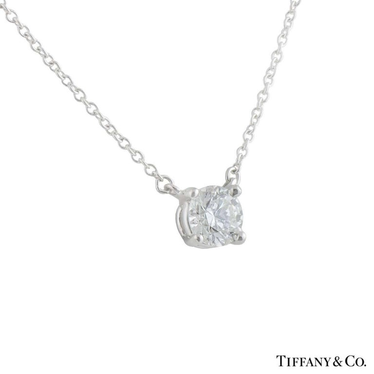 Tiffany and co round diamond pendant 061 carat for sale at 1stdibs a beautiful platinum diamond tiffany co pendant the pendant comprises of a solitaire aloadofball Images
