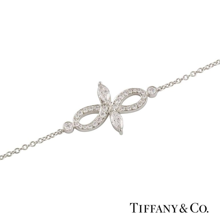 A beautiful 18k white gold Tiffany & Co. diamond bracelet from the Victoria collection. The bracelet comprises of an open work design with 2 marquise cut diamonds at each end with a total weight of 0.13ct, F colour and VS+ clarity. Complementing the