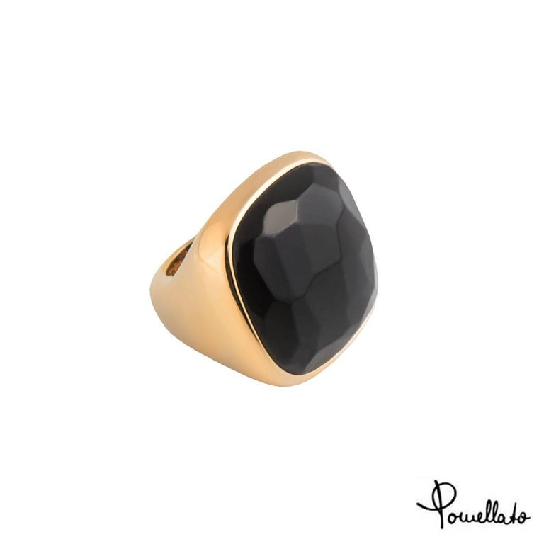 A lovely 18k rose gold onyx Pomellato ring. The ring comprises of a 25.00ct onyx gemstone in a rubover setting. The ring measures 2.8cm in height and width and is a size a UK size L½, US 6, EU 51.5 and has a gross weight of 35.60 grams.  The ring
