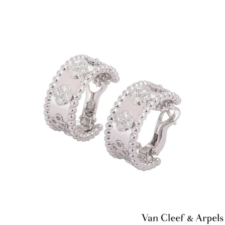 An 18k white gold pair of diamond hoop earrings by Van Cleef & Arpels from the Perlée​ Clovers collection. The earrings comprise of the iconic four leaf clover motifs spaced out evenly in the middle set with round brilliant cut diamonds and a beaded