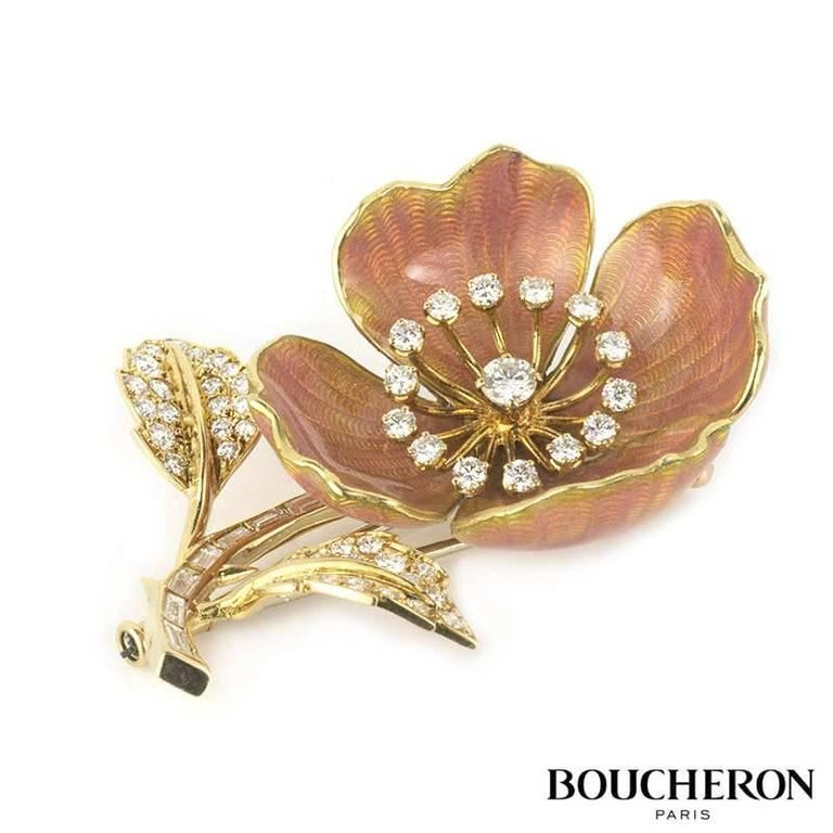 A diamond and enamel Eglantine brooch by Boucheron c.1960. Set in 18k yellow gold and platinum the brooch is designed as an open bloom with diamond set stamen within pale pink guilloche enamel petals. The stem of the flower is set with baguette cut
