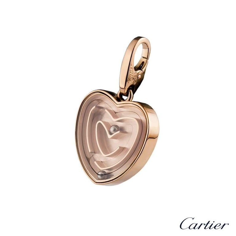 A stylish 18k rose gold Cartier heart maze pendant. The pendant comprises of a heart motif with a maze cased behind a pane of glass. Within the maze are 2 ball bearings freely moving throughout the maze. The pendant measures 17mm in height and 18mm
