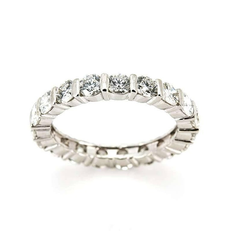 An elegant 18k white gold diamond set full eternity ring. The ring is set with 18 round brilliant cut diamonds each individually set within a four claw setting totalling approximately 1.90ct, G in colour and SI in clarity. The ring measures 3mm in