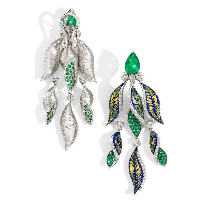 Fern.  Hundreds of Micro Mosaic tesserae, set by hands of unrivaled talent, form soft and flowing leaves that are accompanied by extraordinary emeralds that enhance their royal beauty, along with diamonds placed as dewy drops.  The Micro Mosaic of