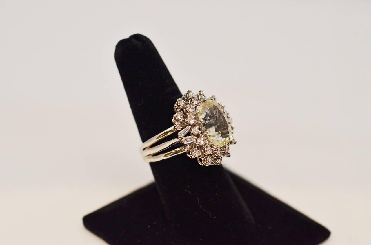Burmese 9.79 yellow sapphire Ring with 1.00 Carats brilliant cut diamonds