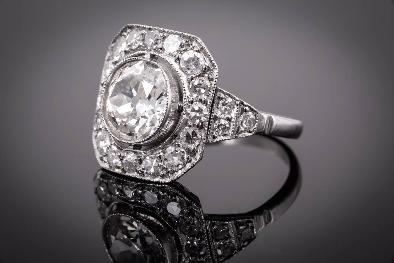 Gorgeous period Art Deco diamond ring. The center diamond is european cut, has J-K color, SI1 clarity and weighs 1.80cts. There are approximately 1.00cts of single cut round diamonds around the center diamond and they have H-I color and VS-SI1