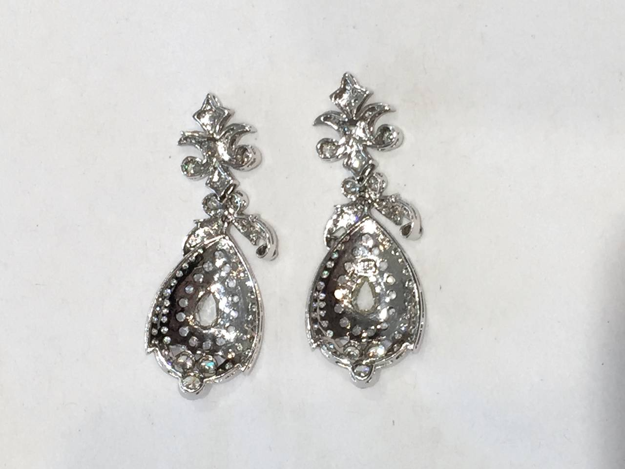 Beautiful Diamond Chandelier Earrings.  The large rose cut pear shaped diamonds in the center weigh approximately .75cts each. The total diamond weight is 5.78cts. The diamonds are a combination of brilliant and rose cut diamonds. The earrings are