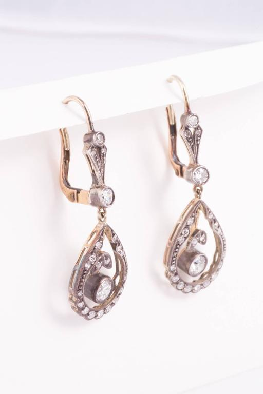 Silver top gold back diamond earrings. The diamond drops are approx. .50ct  each, 1.60ct/tw circa.1900.  Diamond drops are approx. .50ct each, The earrings are approx.1.60ct/tw circa.1900.