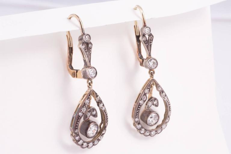 Edwardian Diamond Silver Top Gold Back Earrings In Excellent Condition For Sale In New Orleans, LA