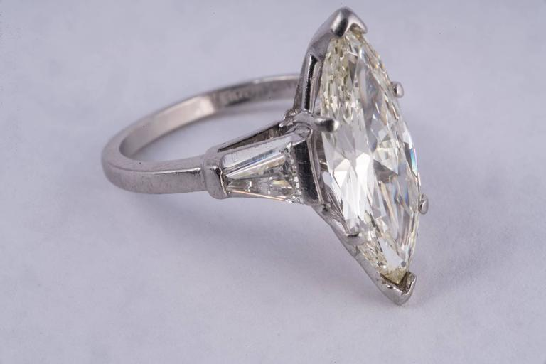 Amazingly large and great looking 2.36ct Marquise diamond ring. This ring is huge and the diamond  is gorgeous! The diamond had J color and VS clarity. It is set in platinum with a large taper baguette on each side.