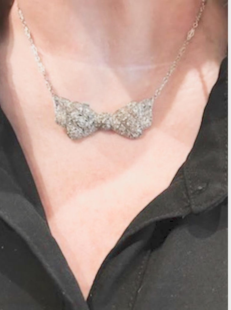 Round Cut Fabulous Diamond Bow Necklace For Sale