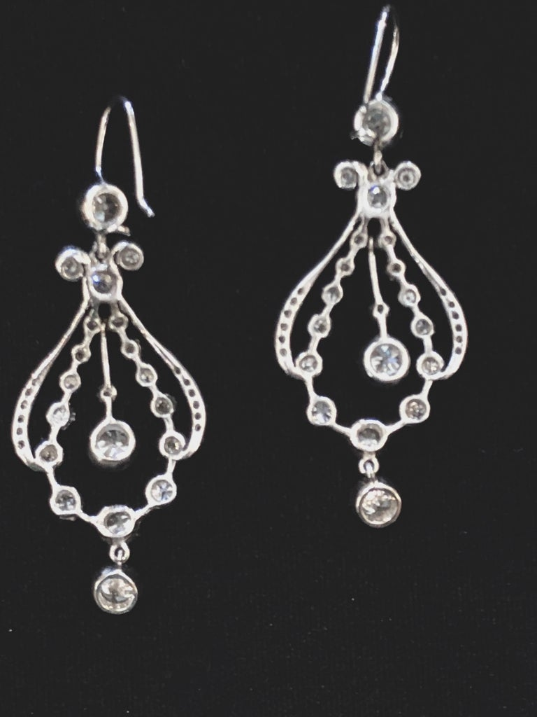 Diamond and platinum chandelier earrings with approximately 7.30cts of diamonds total. There are approximately 3.65cts of diamonds per earring. The diamonds are full cut, have G-H color and VS1-SI1 clarity. With purchase, Empire Antiques will