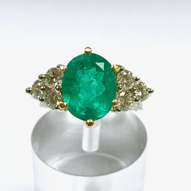 Emerald and Diamond White and Yellow Gold. Emerald 2,81 Carat Diamonds 0,72 Carat Yellow and White Gold 18 Carat Siez 54