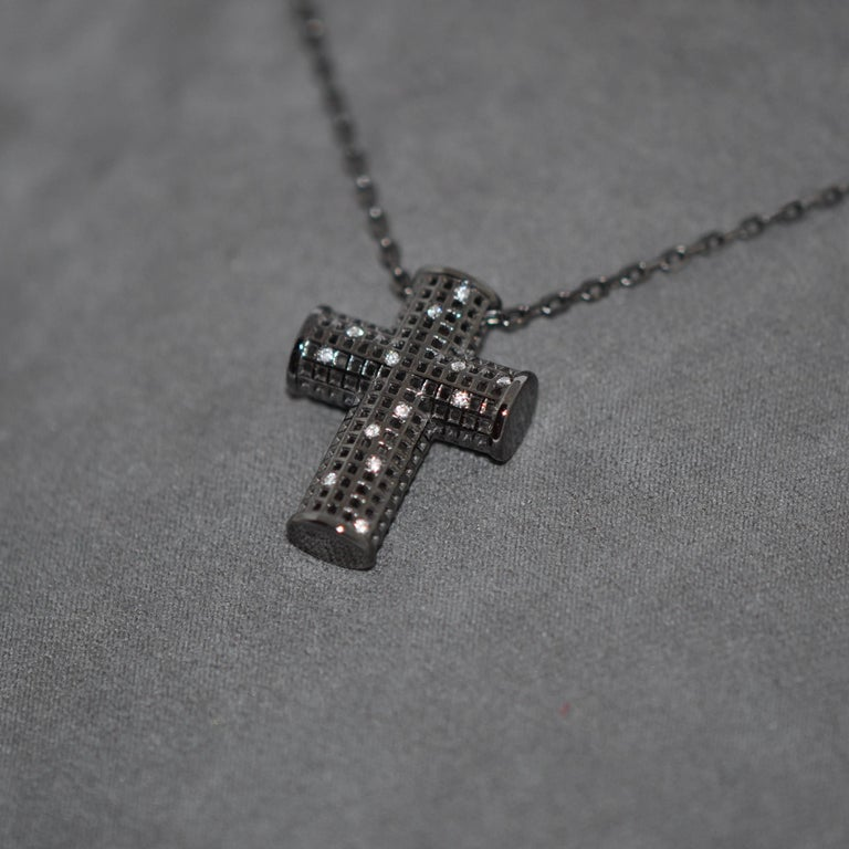 Discover this Cross White Gold Rhodium Black and White Diamonds Pendant Necklace. White Diamonds 0.6 Carat White Gold 18K Rhodium Black White Gold 18K Rhodium Black Chain