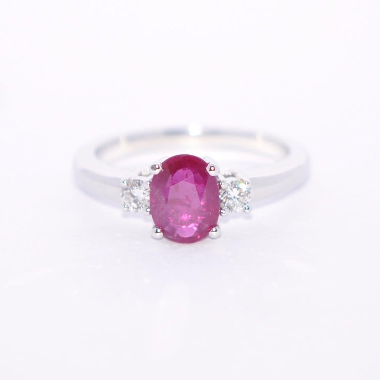 Discover this Rose Ruby and White Diamond on White Gold 18 Karat Engagement Ring. Oval Rose Ruby 1.31 Karat 2 Round White Diamond 0.20 Karat Color G  White Gold 18 Karat  French Size 53  US Size 6.5