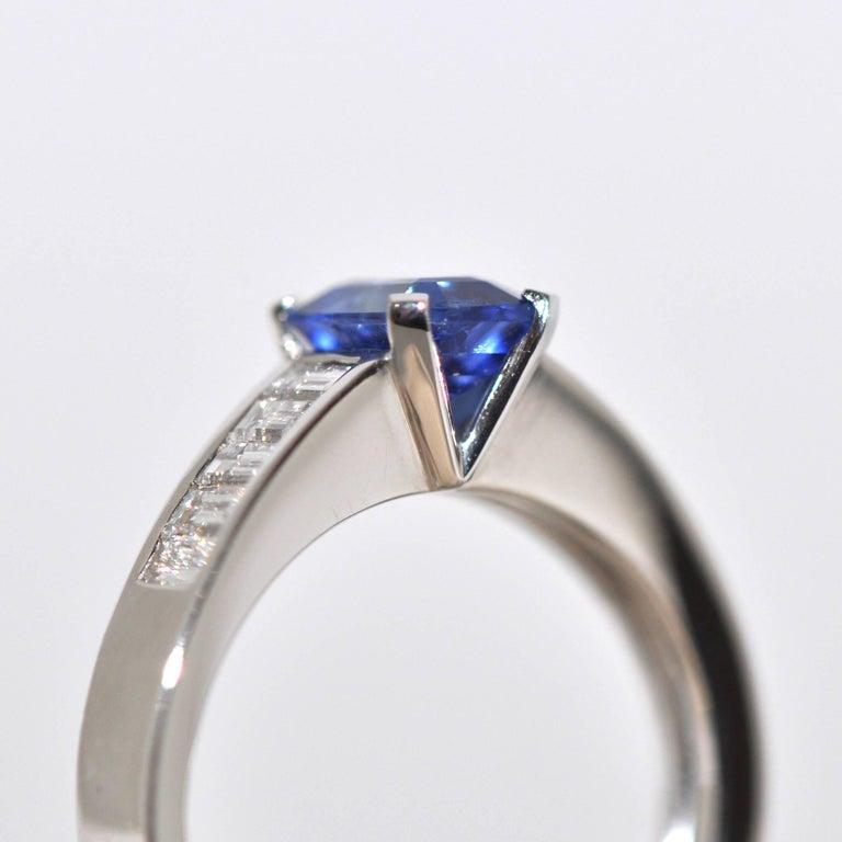 Blue Sapphire Emerald Size and White Diamonds White Gold Unique Ring. Blue Sapphire 1.22 Carat 10 White Diamonds color F/G 0.59 Carat White Gold 18 Carat French Size 53 / US Size 6 1/4