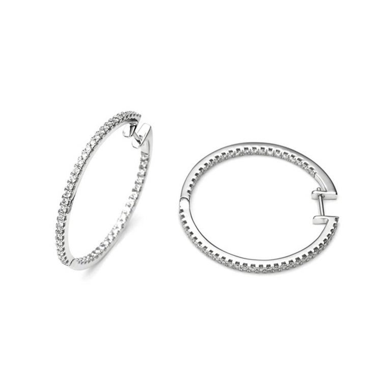 Elegant and Modern White Gold and Diamonds Hoop Earrings. White Gold 18 Carat  102 Diamonds PurityH/ SI Form Brilliant 0, 95 Carat