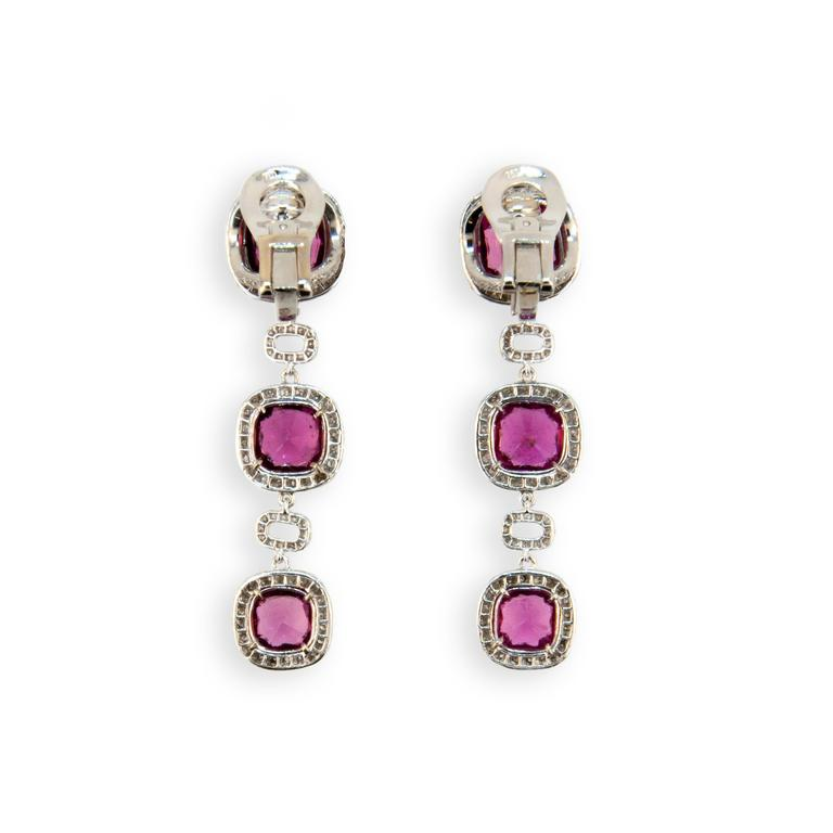 18 karat white gold earrings 9 x 9 mm Rubellite at top with two 8.5 mm and two 7.5 mm Rubellite below 11.57 carats total weight with micro set diamonds surrounding and rectangular diamond sections separating (four hundred sixty four diamonds) 3.01