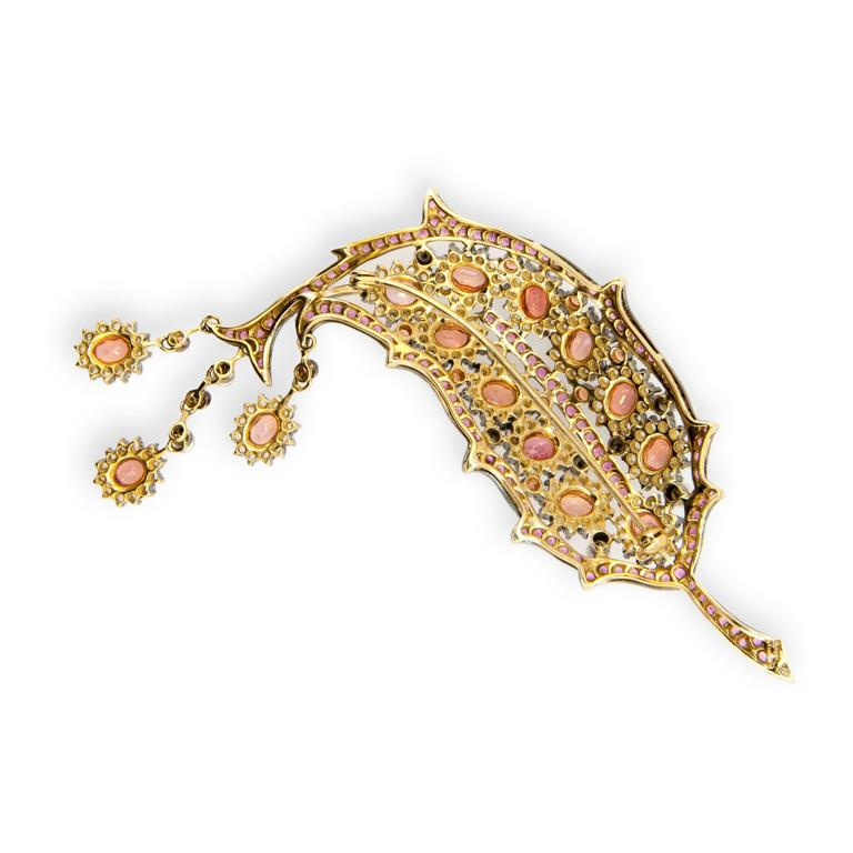 18 karat yellow gold blackened brooch Leaf design 14 oval Padparadscha color sapphires approximately 7.95 carats total weight  12 Round Padparadscha color sapphires approximately .80 carat total weight 120 Round Pink Sapphires approximately 3.95
